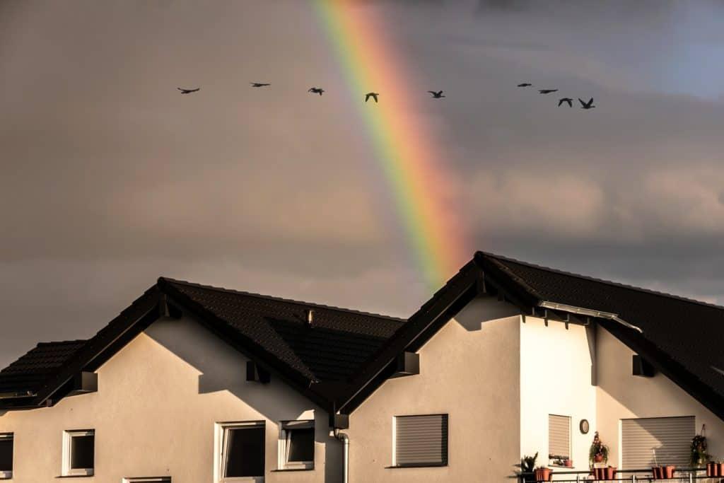 Rainbow over cloudy skies